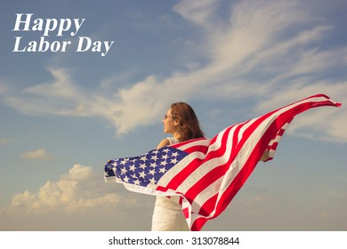 woman stand facing the sky her hands holding usa flag for happy labor day concept.
