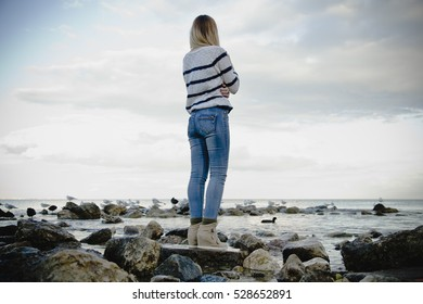 woman stand on the rock see