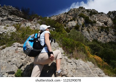 Woman stand at top of mountain