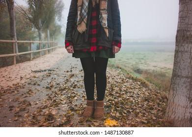 woman standing autumn landscape no face