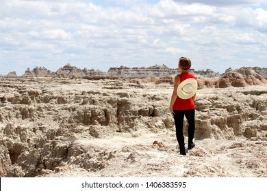 A woman standing in the Badlands National Park in South Dakota.
