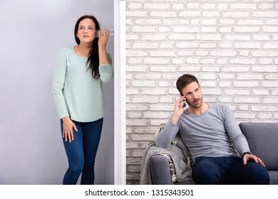 Woman Standing Behind Glass Listening Neighbor Man's Conversation Sitting On Sofa