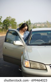 woman standing by her car outdoors