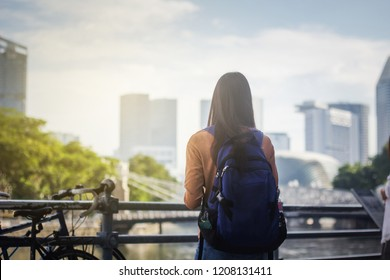 Woman standing with cityscape skyscrapers background.