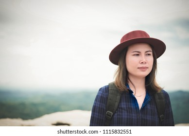 Woman standing at cliff alone