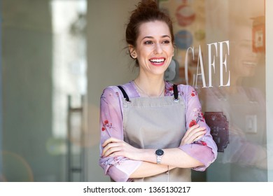 Woman standing in front of coffee shop