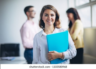 Woman standing in front of her team
