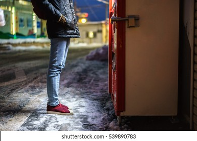 Woman standing in front of vending machine,Woman choosing drink at Night on road side with snowy ground,Japan vending machine in tokyo,High ISO image.