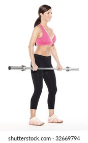 Woman Standing Holding Barbell