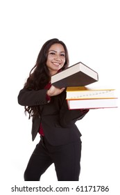 A woman is standing holding a stack of books.