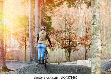 Woman standing with mountain bike