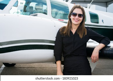 Woman standing next to an airplane