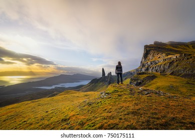 Woman standing at the old man of storr on the Isle of Skye, Scotland.