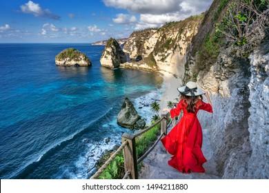 Woman standing on Diamond beach in Nusa penida island, Bali in Indonesia.