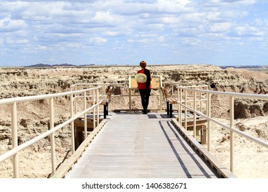 A woman standing on a platform at the Badlands National Park in South Dakota.