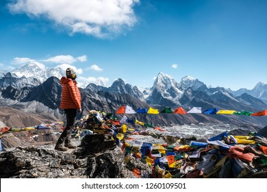 Woman standing on top of Gokyo Ri with view on Mt. Everest, Himalayas, Nepal