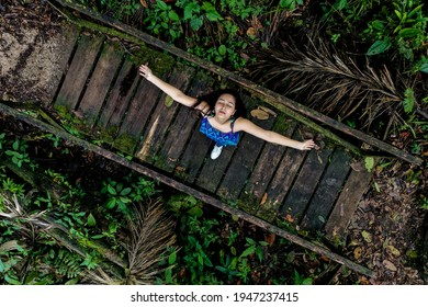 woman-standing-on-wooden-bridge-260nw-19
