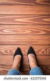 Woman standing on wooden floor