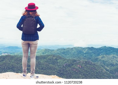 Woman standing sad at cliff alone