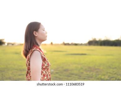 Woman standing with a sad evening sun. sad concept.