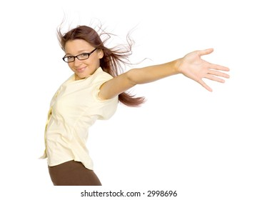 Woman standing in the strong wind. Her arms stretched up. She's smiling. Isolated on white in studio.