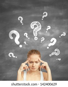 woman standing thinking with question mark over head