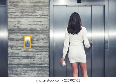 woman standing and waiting the elevator