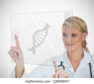 Woman standing while looking at DNA helix hologram interface