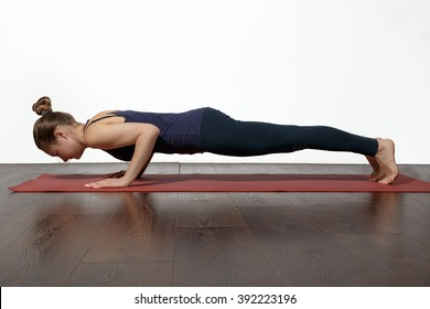Woman standing in yoga pose resting on her arms and legs . Back straight. The concept of a healthy lifestyle