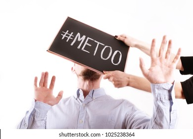 Woman stands up for herself to man behaving inappropriately & hitting him with metoo sign in the face. Strong woman concept. Female gets her revenge for male sexist behavior. Funny fight, background.