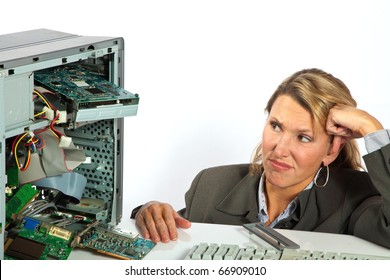 Woman stares with contempt at her broken computer