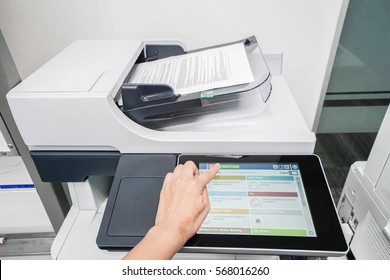 woman start document scanning by office printer