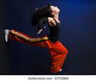 Woman start running very fast forward on dark background