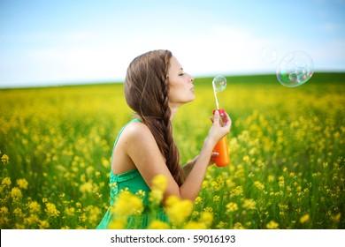 woman start soap bubbles