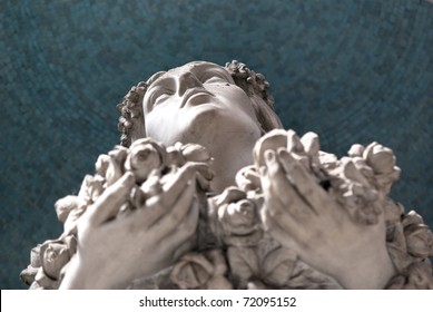 woman statue with eyes up