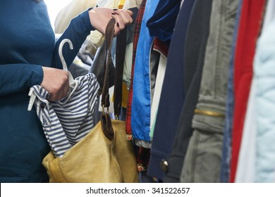 Woman Stealing Clothes From Store