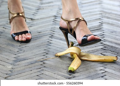 woman stepping on banana skin or peel, accident concept