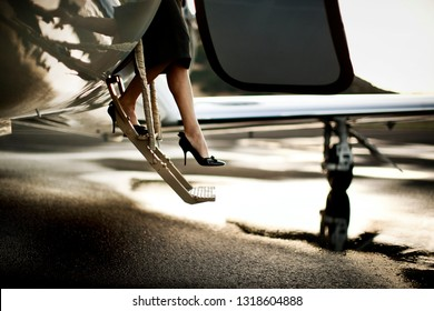 A woman stepping out of a plane