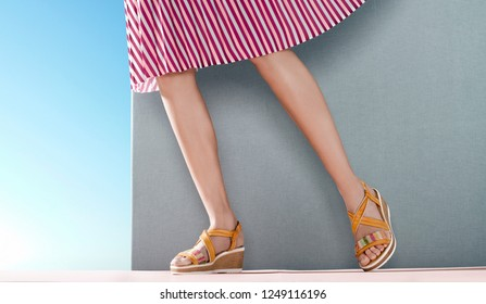 woman steps in miniskirt and shoes