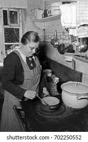 Woman stirring food in pot on stove