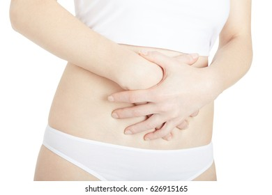 Woman with stomach pain isolated on white, clipping path