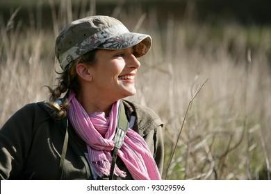 Woman stood in meadow