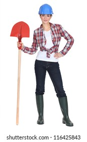 Woman stood with shovel