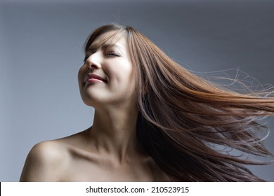The Woman With Straight Hair