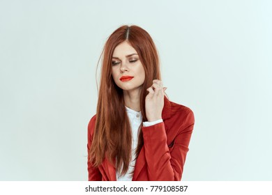 woman with straight hair with closed eyes on a light background