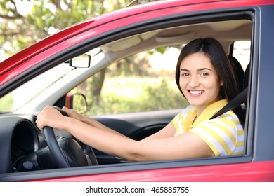 Woman strapped with safety belt in car