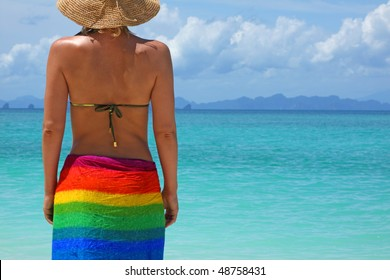 The woman in the straw hat standing on seacoast