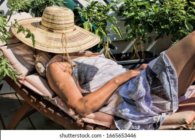 woman with straw hat as sun protection