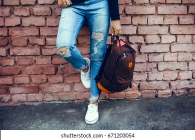 Woman street photo portrait, backpack travel girl,Pretty woman posing in the park, using backpack, travel vibes, hipster girl, outdoor close up portrait, happy face, smile
