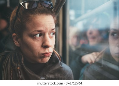 A woman in streetcar alone and annoyed
